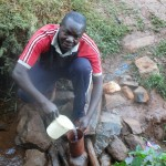 The Water Project : 4-kenya4710-mr-dickson-makutwa-getting-drinking-water