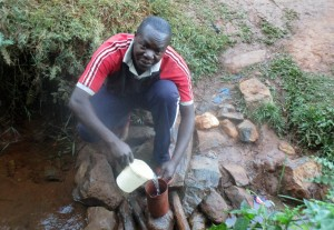 The Water Project:  Mr Dickson Makutwa Getting Drinking Water