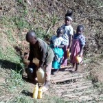 The Water Project: Bumavi Community -  Fetching Water