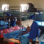 The Water Project: Matende Girls High School -  Form One Students Unpacking