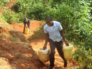 The Water Project:  Elvis Carries Heavy Water Containers