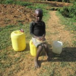The Water Project: Essaba Primary School -  Community Member Waiting To Fetch Water