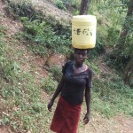 The Water Project: Shitaho Community A -  Balancing On Head
