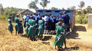 The Water Project : 7-kenya4647-girls-waiting-in-front-of-their-latrines