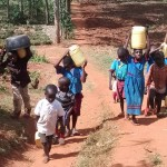 The Water Project: ADC Chanda Primary School -  Fetching Water