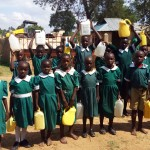 The Water Project: Kalenda Primary School -  Posing With Jerrycans