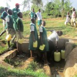 The Water Project: Essaba Primary School -  Waiting At The Spring