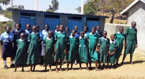 The Water Project:  Girls Pose In Front Of Their Only Latrines