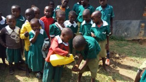 The Water Project:  Demonstrating Hand Washing