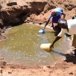 The Water Project: Maluvyu Community A -  Scoop Hole Water