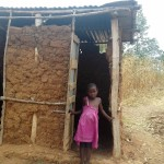 The Water Project: Eshiakhulo Community -  Little Girl Shows Her Latrine