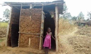 The Water Project:  Little Girl Shows Her Latrine