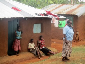 The Water Project : 12-kenya4706-florence-chellagat-with-her-children-outside-her-house