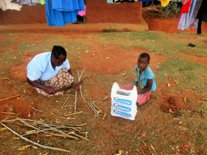 The Water Project : 13-kenya4706-florence-and-her-daughter-cutting-cassava-stems-in-preparation-for-planting-season