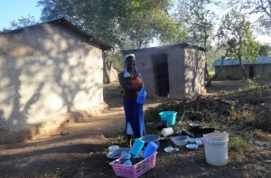 The Water Project:  Woman Washing Dishes