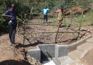 The Water Project : 14-kenya4696-community-members-come-together-to-fence-their-spring