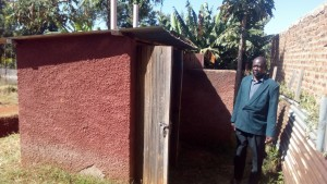 The Water Project:  Principal Omutondo By Teacher Latrines