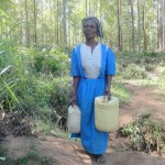 The Water Project: Murumba Community -  Woman Carries Her Jerrycans To The Spring