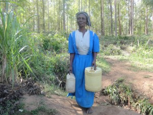 The Water Project:  Woman Carries Her Jerrycans To The Spring