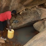 The Water Project: Mbindi Community B -  Current Water Source For Distant Families
