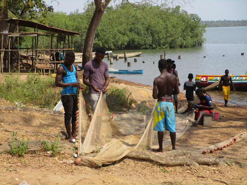 The Water Project : 4-sierraleone5112-mending-nets