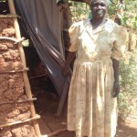 The Water Project: Visiru Community, Kitinga Spring -  Ester Aguiya By Her Latrine