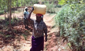 The Water Project:  Catherine Lumadede Balancing Water On Her Head