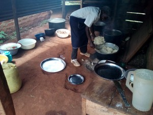 The Water Project:  Cook Serves Meal