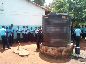 The Water Project:  Students Eat Around One Of The Tanks