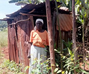 The Water Project:  Outside Her Latrine