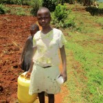 The Water Project: Mahanga Community -  Carrying Water