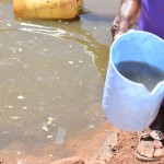 The Water Project: Maluvyu Community -  Scoop Hole Water