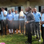 The Water Project: Bumuyange Secondary School -  Trainer Erick Wagaka Demonstrating Water Treatment