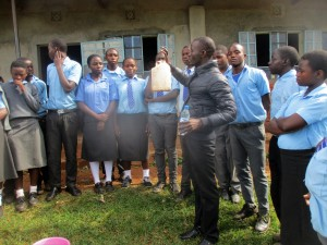 The Water Project:  Trainer Erick Wagaka Demonstrating Water Treatment