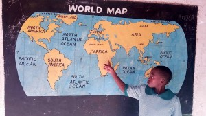 The Water Project:  Pupil Shows Position Of Her School On The World Map