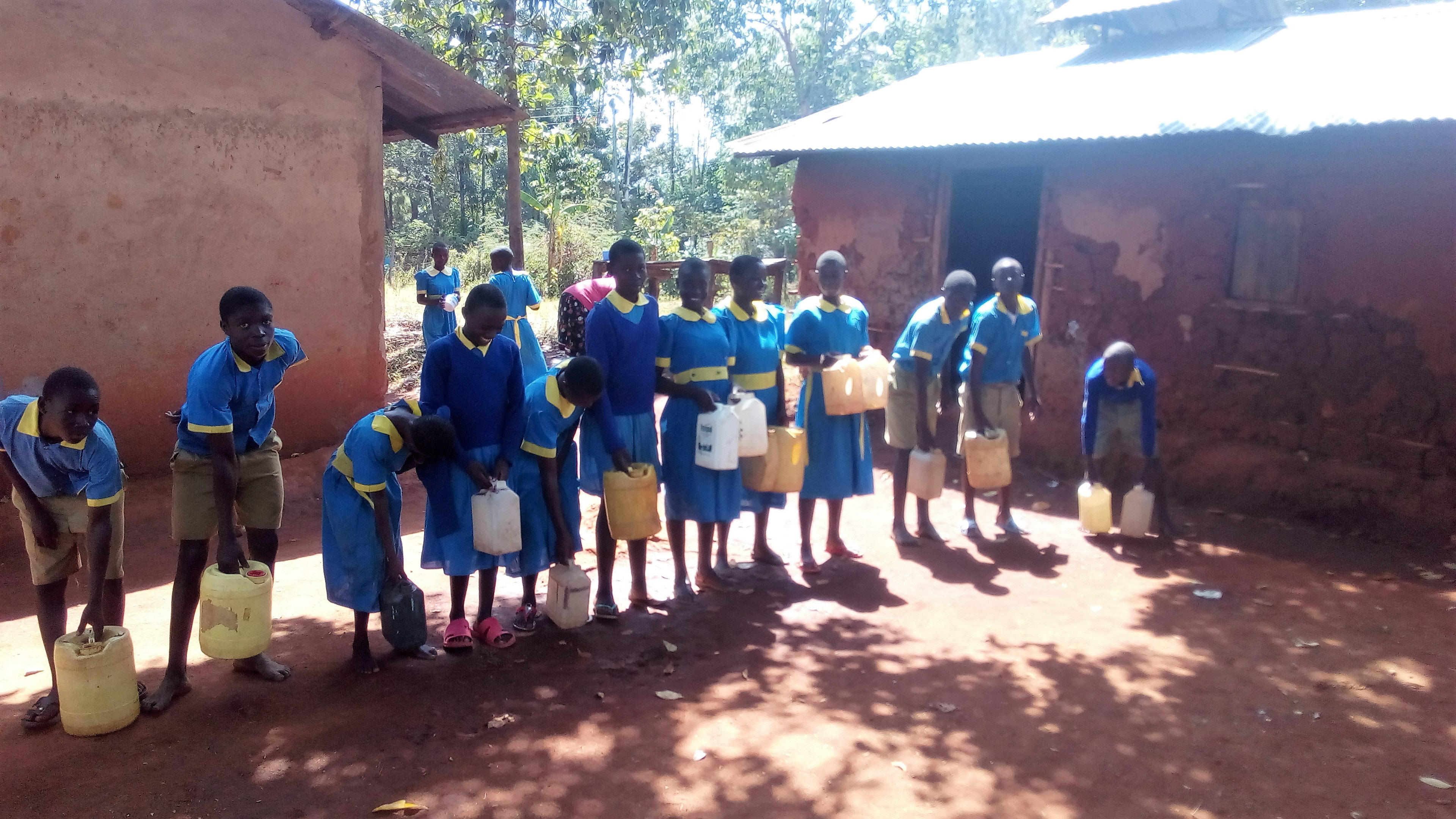 The Water Project : 1-kenya4665-students-with-water-from-home