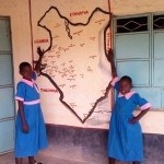 The Water Project: Maganyi Primary School -  Alice And Jane Pose Next To Africa Map