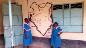 The Water Project:  Alice And Jane Pose Next To Africa Map
