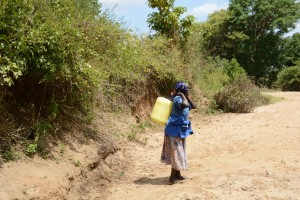 The Water Project:  Family One Fetching Water