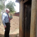 The Water Project: Emulakha Primary School -  Headteacher Gives Us Tour Of Latrines