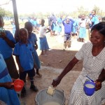 The Water Project: Bumini Primary School -  Serving Porridge To Early Education Students