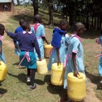 The Water Project: Muhudu Primary School -  Students With Their Water Containers