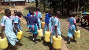 The Water Project:  Students With Their Water Containers