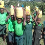 The Water Project: Emusoma Primary School -  Students Posing With Their Water