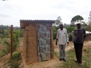 The Water Project:  Charles And Andrew Amala Stand By Their Household Latrine