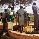 The Water Project: Eshisuru Primary School -  Students Waiting At The Well