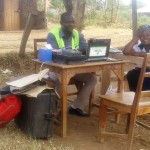 The Water Project : 11-kenya4670-government-staff-registering-local-voters