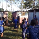 The Water Project: Iyenga Primary School -  Rushing To Use The Latrines