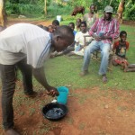 The Water Project: Eluhobe Community -  Silas Mutie Demonstrates How To Wash Hands With Water And Ash
