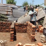 The Water Project: Matende Girls High School -  Artisan Explaining Construction Process